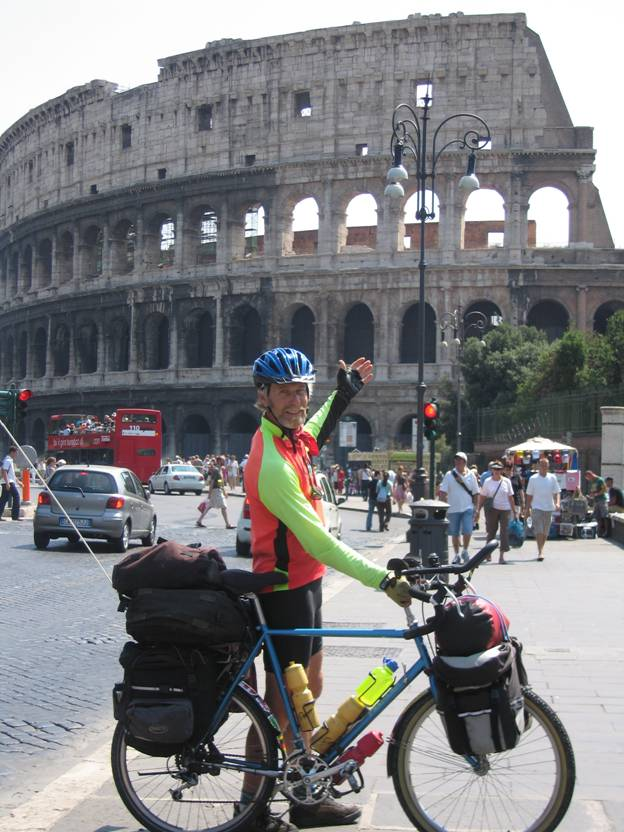 Touring cyclist standing in front of the Coliseum, Rome, Italy © 2012 Frosty Wooldridge