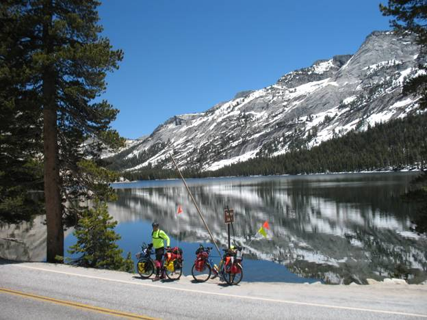 Touring cyclist stopping for lunch, Lake Tenaya, Sierra Mountains, California © 2012 Frosty Wooldridge