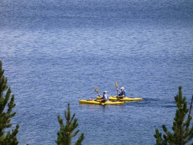 Two kayakers on Yellowstone Lake, Yellowstone National Park, Wyoming © 2012 Frosty Wooldridge